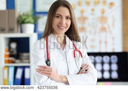 Young Woman Doctor In Uniform With Red Stethoscope In Clinic