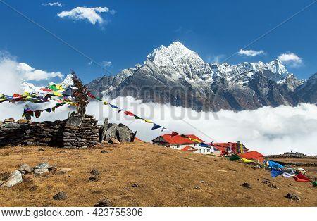 View Of Mount Thamserku, Kongde Village And Prayer Flags, Khumbu Valley, Solukhumbu, Nepal Himalayas