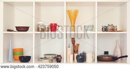 Kitchen Utensils And Tableware On White Shelves. Well Organized Kitchen Concept. Modern Interior.