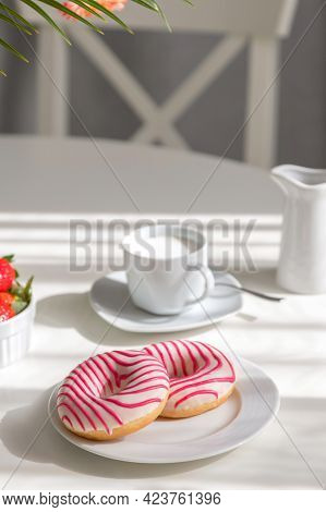 Donuts For Breakfast. Beautiful Striped Donuts On A White Plate With A Cup Of Fresh Cappuccino On Th