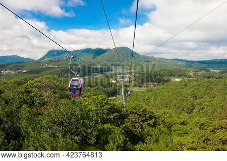 Cable Car With Landscape Green Forest And Mountain And Blue Sky With White Cloud Background. At Dala