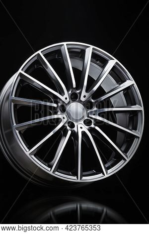 Sport Alloy Wheel, Vertical Photo On A Black Background