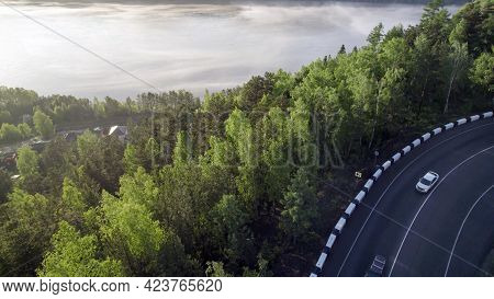 Fog Over The River, Forest And The Edge Of The Asphalt Road On The Hill, Beautiful View Of The Trave