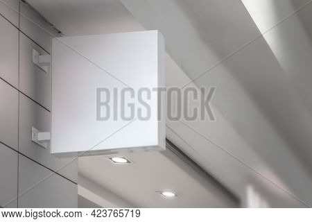 White Signboard Mockup Template, On The Facade Of A Store Or Bank, An Empty Ad For Your Layout