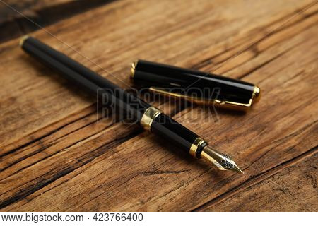 Beautiful Fountain Pen With Ornate Nib On Wooden Table, Closeup
