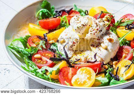 Burrata Cheese Salad With Arugula And Tomatoes. Italian Cuisine Concept.