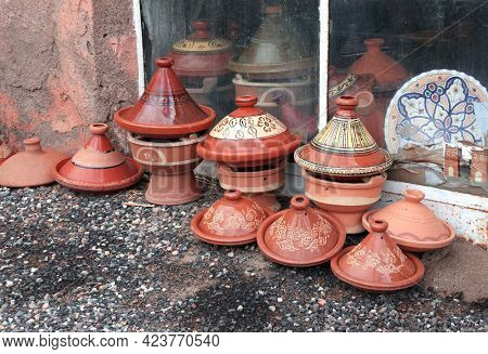 Traditional moroccan souvenirs - hand-painted ceramic tajine dish, street market (souk) in Essaouira, Morocco, North Africa