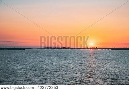 Sweden. Beautiful Seascape In Sunset Sunrise Time. Sun Sunshine Above Rocky Islands Archipelago. Sun