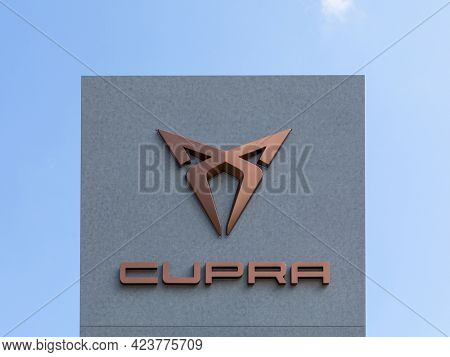 Stade, Germany – June 2, 2021. Copper signage on pole identifying CUPRA car dealership. SEAT Cupra, S.A.U. is the motorsport subsidiary of Spanish automobile manufacturer SEAT