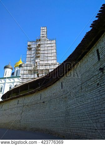 Old Ancient Stone Wall Of Kremlin Pskov, Russia. Trinity Cathedral. Bell Tower Renovation, Scaffoldi