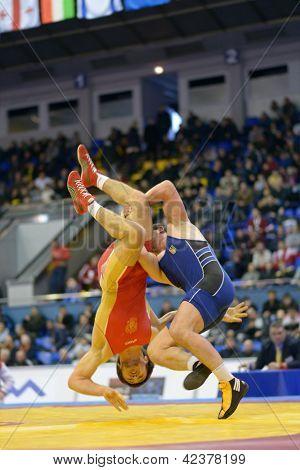 KIEV, UKRAINE - FEBRUARY 16: Match between Rabadanov, Russia, red and Aldatov, Ukraine during XIX International freestyle wrestling tournament in Kiev, Ukraine on February 16, 2013. Motion blur