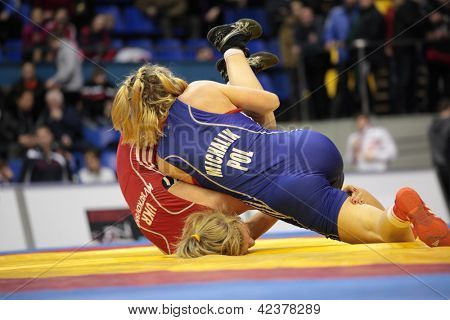 KIEV, UKRAINE - FEBRUARY 16: Match between Michalik, Poland, blue and Kvyatkovska, Ukraine during International freestyle wrestling and female wrestling tournament in Kiev Ukraine on February 16, 2013