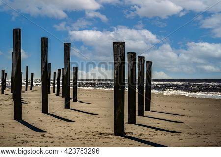Petten Aan Zee, The Netherlands. March 2021. The Wooden Pole Village At The Beach Near Petten. High