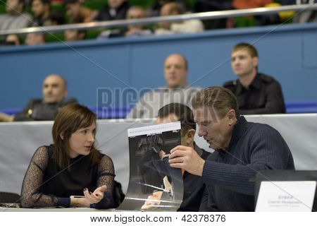 KIEV, UKRAINE - FEBRUARY 16: Champion Elena Kostevich (left) and President of NOC Sergey Bubka during XIX International freestyle wrestling tournament in Kiev, Ukraine on February 16, 2013
