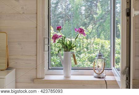 White Window With Mosquito Net In A Rustic Wooden House Overlooking The Garden. Bouquet Of Pink Peon