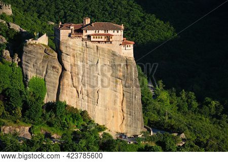 Monastery of Rousanou perched on a cliff in famous greek tourist destination Meteora in Greece on sunset with scenic landscape