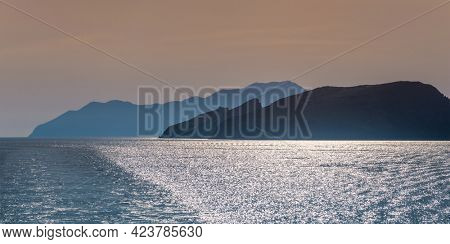 Panorama of Cyclades greek islands silhouettes in Aegean sea. Greece