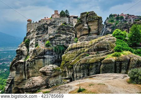 Monastery of Varlaam monastery and Monastery of Great Meteoron in famous greek tourist destination Meteora in Greece on sunset with scenic scenery landscape