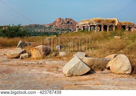 Ancient Vijayanagara Empire civilization ruins of Hampi now famous tourist attraction. Hampi, Karnataka, India