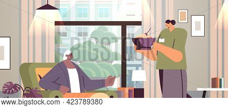 Friendly Nurse Or Volunteer Bringing Food To Elderly Woman Patient Home Care Services Healthcare And