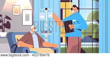 Friendly Nurse Or Volunteer Checking Dripper Of Elderly Man Patient Home Care Services Healthcare An