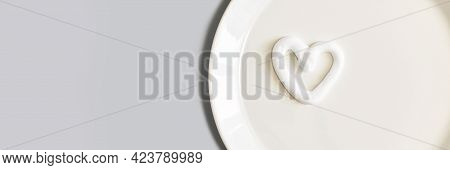 Heart Shape Cream. Beauty Lotion. Mayonnaise Smear On White Plate. Top View With Copyspace. White Pr
