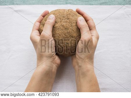 Women's Hands Knead Dough For Homemade Bread. Step By Step Bread Recipe. Baking Process. Homemade Or