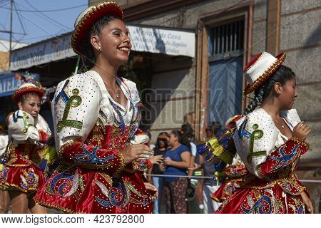Arica, Chile - January 23, 2016: Female Members Of A Caporales Dance Group In Ornate Red And White C