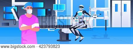 Male Doctor Surgeon In Protective Mask Working With Robot In Clinic Surgery Room Medicine Healthcare