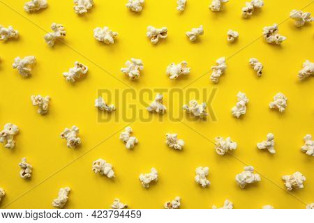 Popcorn Scattered On Yellow Background. Popcorn Pattern. Top View.