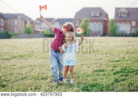 Happy Canada Day. Caucasian Siblings Brother And Sister Holding Waving Canadian Flag. Kids Children