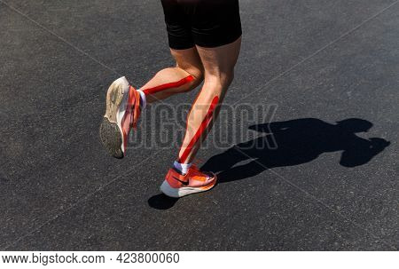 Chelyabinsk, Russia - May 30, 2021: Male Runner Athlete Running Shoes In City Race