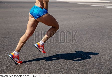 Chelyabinsk, Russia - May 30, 2021: Female Runner Athlete Running Shoes In City Race