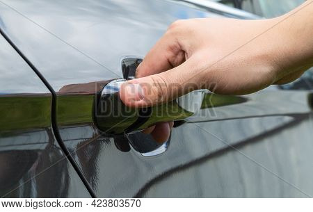 A Mans Hand Opens A Car Door. Car Theft Concept, Macro. Lifestyle