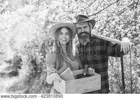 Gardening Is Thier Hobby. Happy Couple Hold Gardening Tools. Gardening And Homesteading. Hobby Farm.