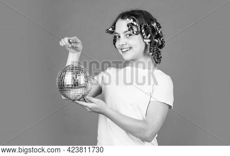 Fashion Girl Posing In Curlers On Orange Background. Saturday Night And Disco Ball. Baby Shower Part