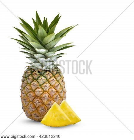 Whole Pineapple And Pineapple Slice. Pineapple With Leaves Isolate On White. Full Depth Of Field .