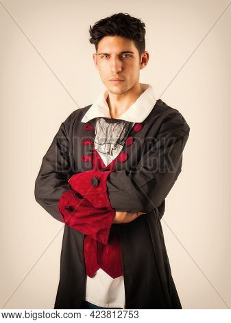 Young Man In Old Fashioned Garment In Studio Shot