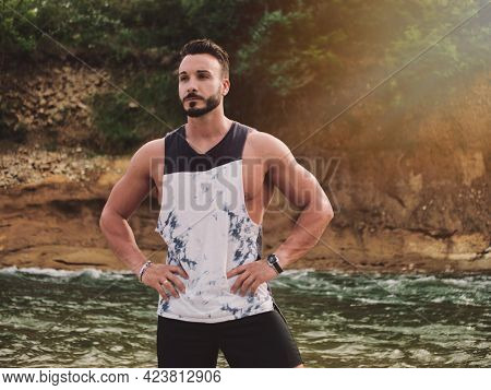 Handsome Athletic Young Man Near River, Standing