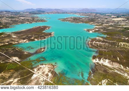 Drone Point Of View Embalse De La Pedrera Reservoir Large Turquoise Colored Lake Used As Source Of W