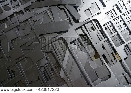 parts of the waste after processing on a laser cnc machine. scrap metal. metal residues after laser cutting