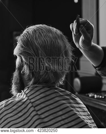 Guy With Long Dyed Blond Hair Close Up. Do Not Cut Your Own Hair. Barber Works On Hairstyle For Bear