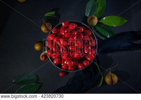Nutmeg Seeds In Round Pot - Leaf And Cloths - Dark Background, Nutmeg Fruits And Seeds On Dark Backg