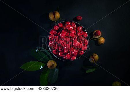 Nutmeg Seeds In Round Pot And Nutmeg Fruits Green Leaf , Nutmeg Fruits And Seeds On Dark Background,