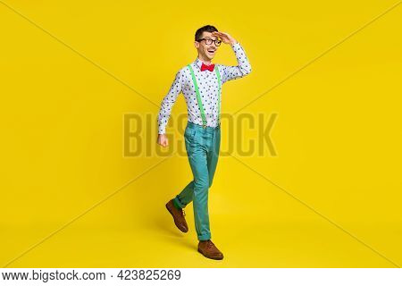Full Body Profile Side Photo Of Young Excited Man Happy Positive Smile Go Walk Look Forward Isolated