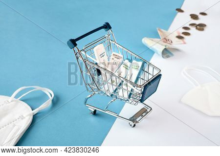 Cost Of Shnelltest, Express Corona Test In German Language. Shopping Cart With Covid 19 Antigen Test