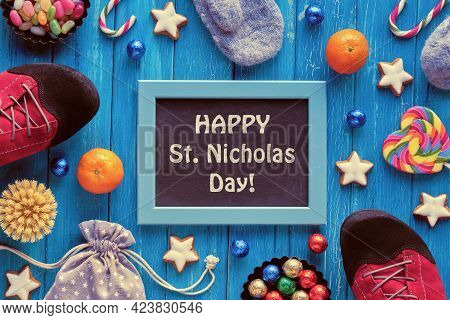Text Happy St Nicolas Day On Blackboard, Chalk Board. Traditional Holiday In Germany And Western Eur