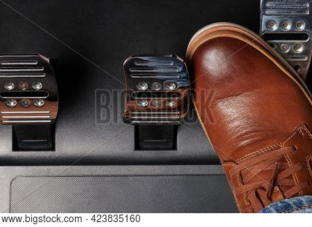 Press Accelerator Car Pedal Via Brown Shoe Clsoe Up Above Top View