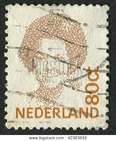 NETHERLANDS - CIRCA 1991: A stamp printed in Netherlands shows image of Beatrix (1880), Queen regnant of Netherlands, circa 1991.