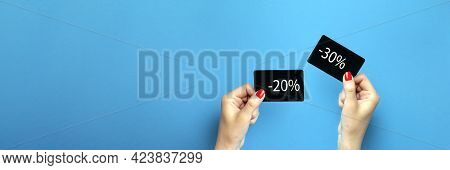 Discount Card In Hand. Discount On Purchases 20 , 30 , Percent. A Woman Is Holding A Black Discount